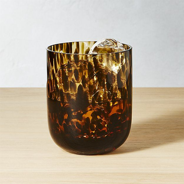 Shop Franklin Brown Drinking Glass.   Light and dark brown tones mimic tortoise pattern for dressed-up drinks.  A bit of heft makes it easy to hold.  Franklin Double Old-Fashioned Glass is a CB2 exclusive.