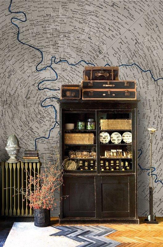 map and vintage shelf and luggage, herringbone floor
