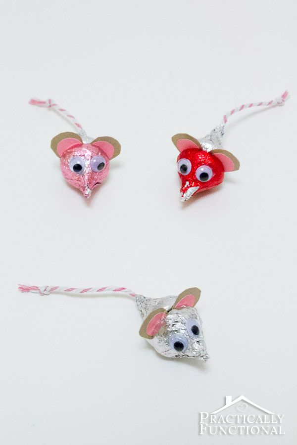 Valentine's Day Hershey's Kisses Mice: These adorable handmade Valentine's Day crafts only take five minutes to put together, and all you need is a bag of Hershey's Kisses, paper, string, googly eyes, and non-toxic glue!