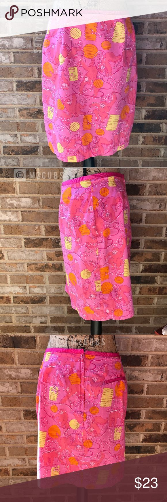 """Lilly Pulitzer Strawberry Barrel of Monkeys Skirt VGUC. Bright pink skirt with monkeys scattered throughout. Eyelet closure however fabric piece is missing to close. Waist approximately 14"""" laying flat, length approximately 19"""". All photos taken in natural light. Photos may not be used without permission. 💰Reasonable offers welcome. Lilly Pulitzer Skirts"""