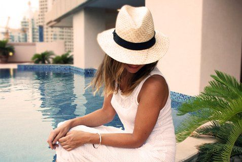 Summer white wide brimmed womens straw fedora hat black band