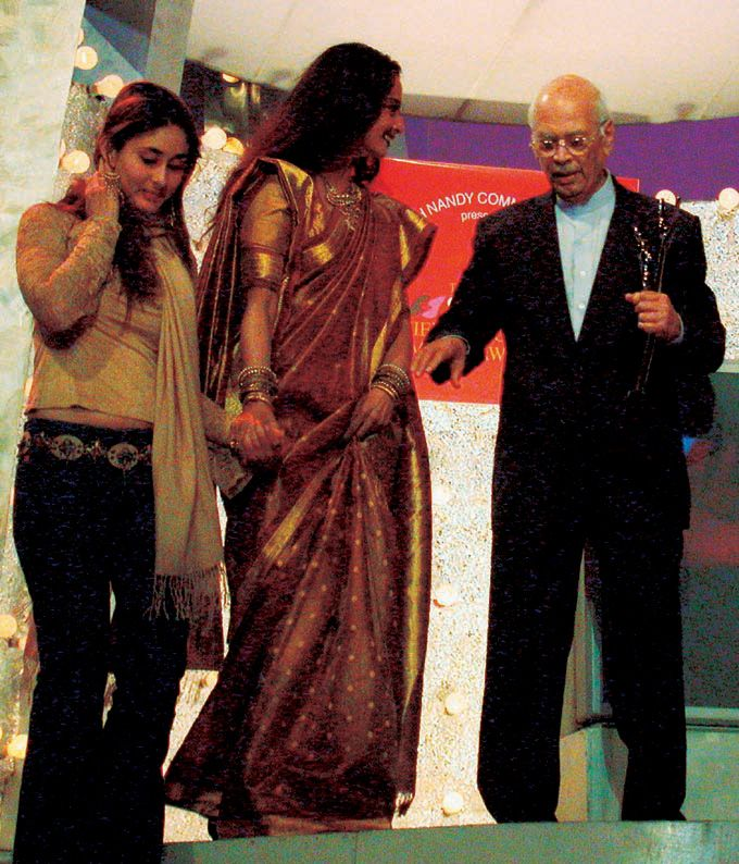 He founded Dharma Productions in 1976 and made Hindi films that were noted for featuring lavish sets and exotic locations, but upheld Indian traditions and family values. The first film produced by the company 'Dostana' was the first silm produced by the company and was a huge box office success. In pic: Kareena Kapoor and Rekha present an award to Yash Johar