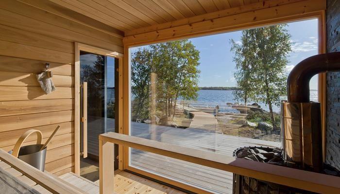 Kide sauna with huge panorama windows. Honka holiday homes.