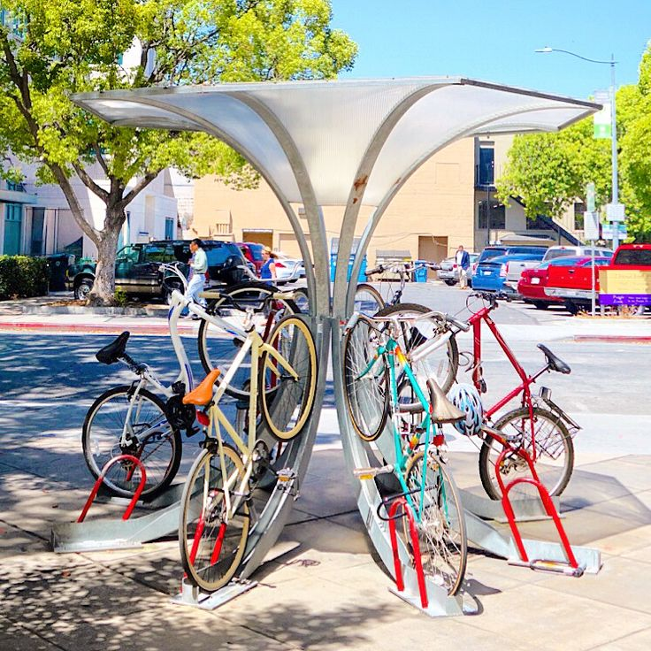 Artistic, space-efficient bicycle parking by www.bikearc.com.