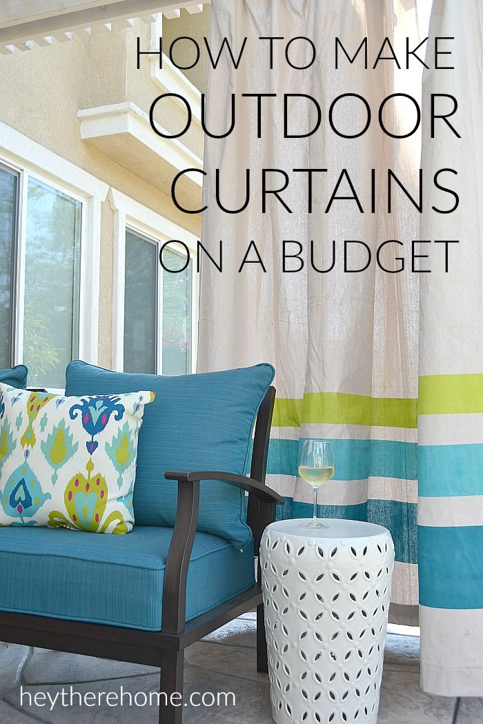 WOW! This outdoor living room is amazing and has so many smart (budget friendly) ideas like these outdoor curtains made from drop cloths! via @heytherehome