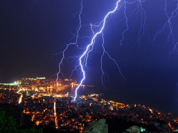 City Strike  Photograph by Mavroudakis Fotis, My Shot    Lightning strikes Kavala, Greece. The ancient Greek god Zeus was said to control lightning, but today we know lightning comes from a difference in electrical charge between clouds and the ground or among clouds.