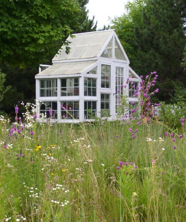 Build your own greenhouse or garden house with upcycled window frames & corrugated sheet roofing.