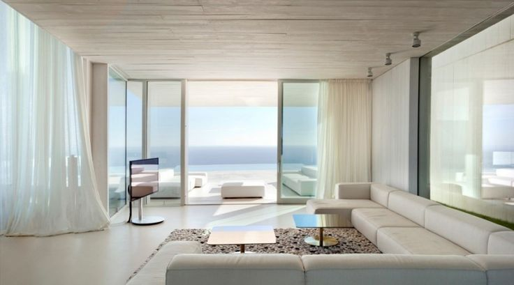 A Modern Homestead That Have View Of The Mediterranean Sea in Iiberian Peninsula From Hillside : Contemporary Living Room Residence Gravel And White Marble Floor Sectional Sofa Coffee Table Lcd Tv White Curtain Wide Glass Window And Slide Door Also Ceiling Lighting