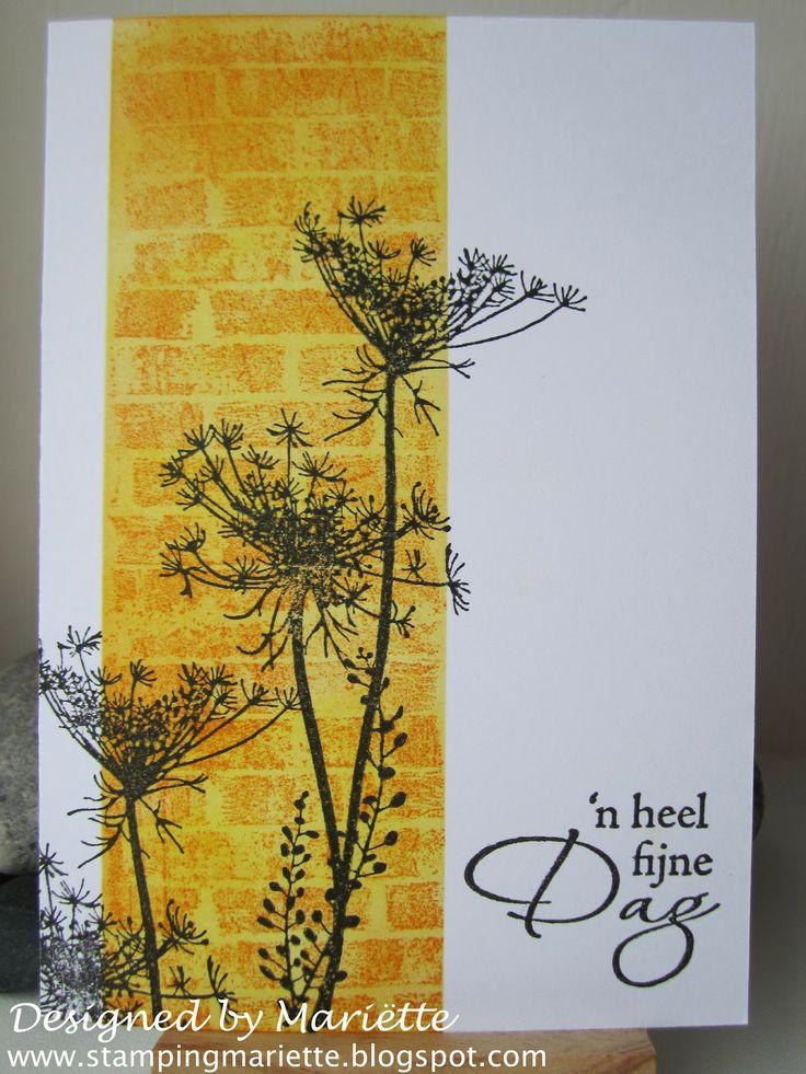 Magenta stamps: wild flower umbella and bricks background
