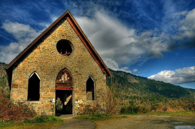 """Built in 1870, this abandoned old stone church in Cowichan Bay, BC is known as the """"Butter Church"""" because it was funded by the sale of butter from the church dairy.  I love the sky in this picture!"""