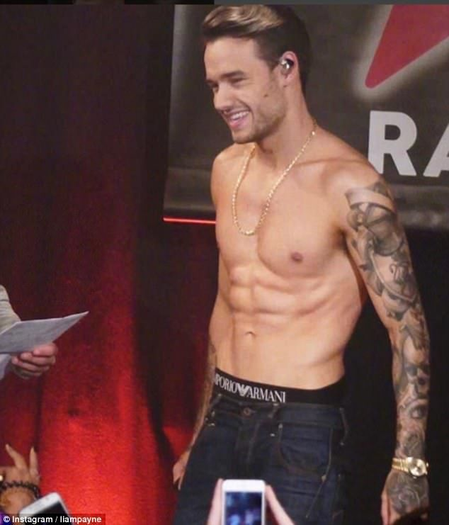 Why hello: Liam Payne, 23, proved that away from nappy changing and feeding time he was still a hunky young star as he went shirtless to perform his new single Strip That Down at a gig in Paris