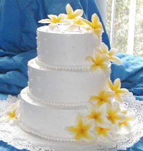blue and yellow Beach Wedding  | Frangipani wedding cake with yellow satin ribbon