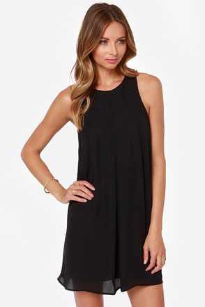 """Go for a classic look with contemporary flair in the Modern Audrey Black Dress! Light woven material flows from a chic high rounded neckline and sleeveless bodice boasting delicate darting detail atop a flirty A-line cut. A small keyhole opening can be found at back below a looping button closure. Lined in a stretch knit. Model is 5'9"""" and is wearing a size small. 100% Polyester. Hand Wash Cold. Imported."""