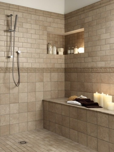 A walk-in shower with sitting room and an alcove for all the shower essentials. I like the corner built-in shelf.