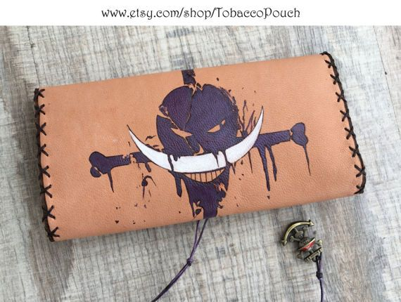 Genuine leather tobacco pouch in natural color. The design was burned with pyrographer and painted with special indelible leather colors. The case can be made for pipe smokes too. Please contact me for costumisation (NOT EXTRA CHARGED). Other Amime heros are available too. If you like