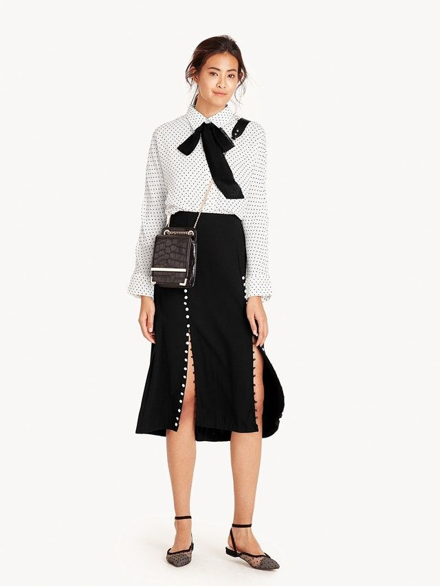 2cbfabf73a Crafted in a thin and sturdy polyester, this midi skirt offers a slight A-