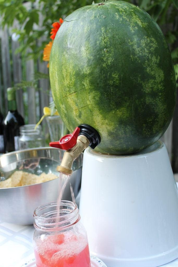 Watermelon with a Spigot - great idea! First, hollow out the melon, then add your drink mixture, thread in the spigot, and you're done!