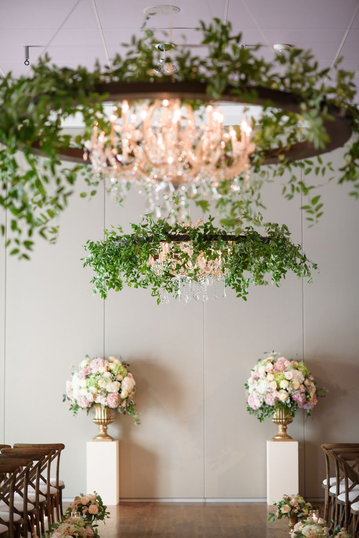 Urban garden wedding and greenery dripping chandelier: Photography : Averyhouse Read More on SMP: http://www.stylemepretty.com/illinois-weddings/chicago/2016/11/16/greenery-chandeliers-urban-garden-wedding/