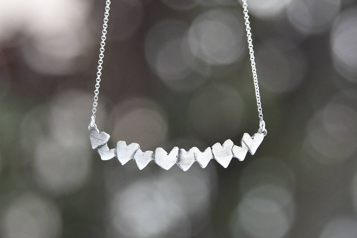 A beautiful silver necklace made by Bead A Boo.   Find it on Etsy.