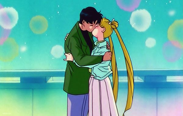 """Sailor Business: A Sailor Moon Anime Podcast! Episode 077 - The Maxfield Stanton Memorial Small Business Grant: The Miracle Romance Returns! That's right--heterosexuality rears its normative reinforcing head once more as Serena/Usagi/Sailor Moon gets back together with Darien/Mamoru/Tuxedo Mask! Jordan rejoices, Chris winces, and our new guest Anita Petrie joins us from Bangkok! Plus--don't forget, my trashpiles, to pick up a """"Moon Pudding"""" T-Shirt at the Sailor Business T-Shirt Club!"""