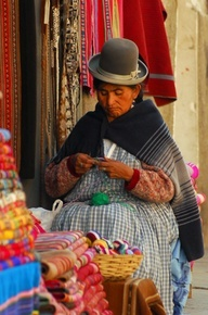Local woman knitting, La Paz, Bolivia. When you travel, remember that watching the locals is just as interesting as seeing the big sites! You can learn so much about people and how they live.