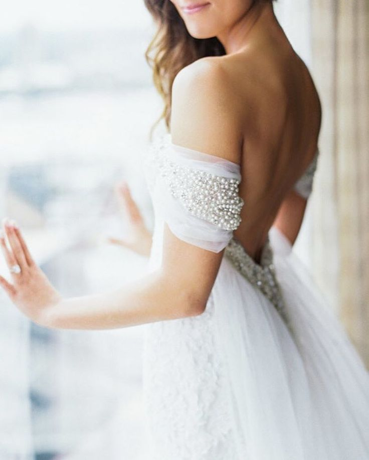"""""""Excuse us while we drool over this #weddingdress! Low-back, off-the-shoulder sleeves and embellishments - it has everything you could ever want! 