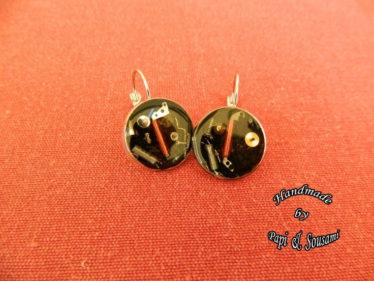 Resin steampunk earrings with tiny parts of old mechanical watch parts