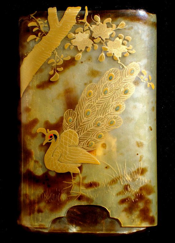 Antique tortoise shell opium box or cigarette case with peacock design.