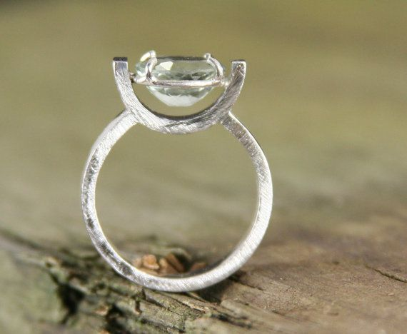 Modern sterling silver ring with green amethyst.