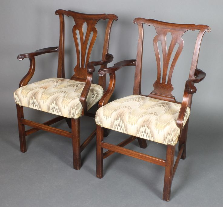 Lot 973, A pair of Georgian mahogany slat back carver chairs with pierced vase shaped slat backs, upholstered over-stuffed seats, raised on square tapering supports with H framed stretcher, sold for £180