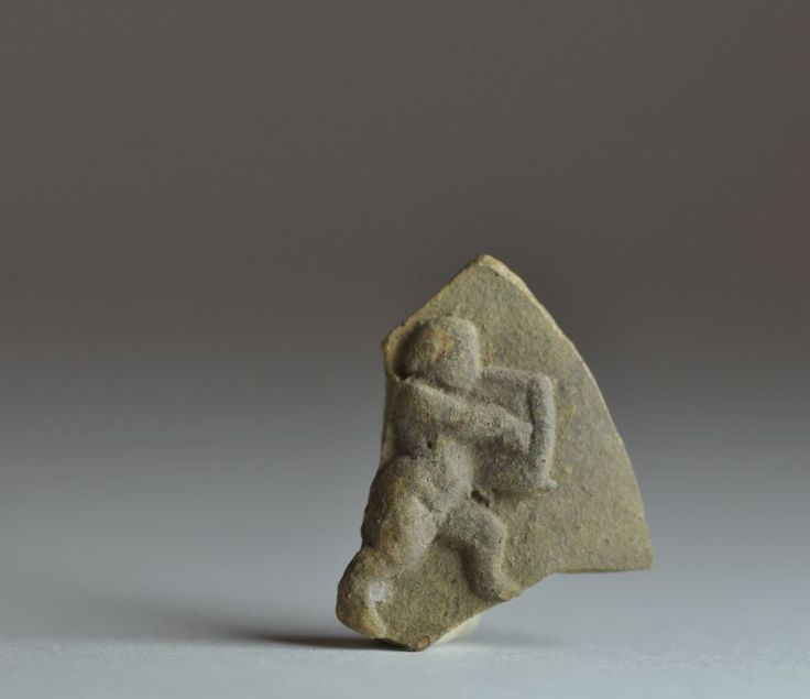 Terra sigillata Samian ware shard with Eros playing lyre, 2nd century A.D. Private collection