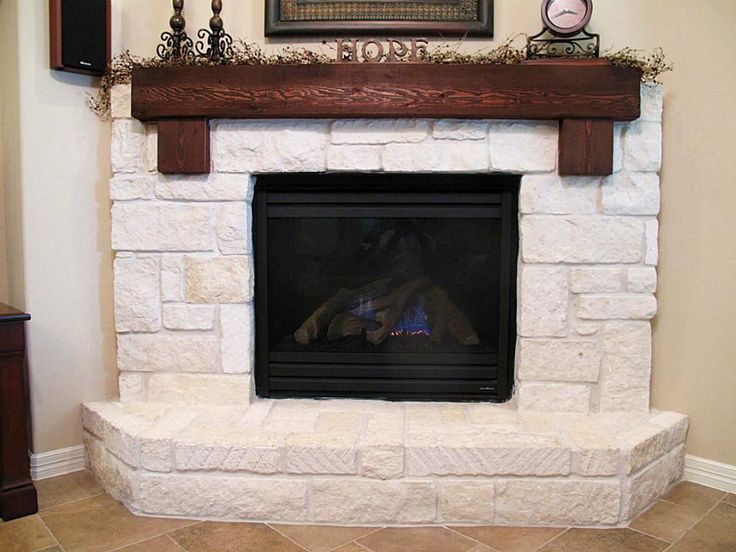 Limestone hearth with cedar mantle home style for Austin stone fireplace
