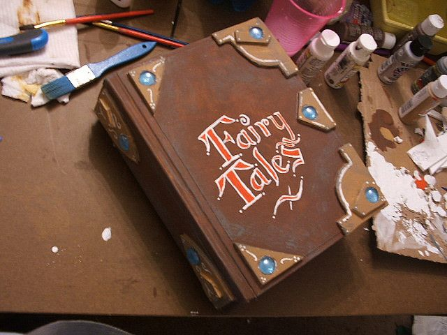 "Making a fairy tale book prop. Need to create 3 or 4 books that Fiona can ""tear apart"" during her song ""I Know It's Today"". Maybe they could be made out of cardboard, felt and velcro even?"