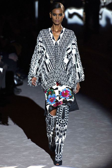 Tom Ford Fall 2013. 1980-2008 Costume for Men and Women: kente cloth itself is not often used in today's fashion industry, but many designers take inspiration from the colorful, patterned fabric.