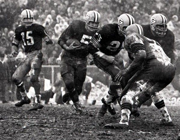 Green Bay Packers halfback Paul Hornung (5) follows running back Tom Moore and a Packers lineman against the Cleveland Browns defense during the NFL championship game at Lambeau Field on Jan. 2, 1966. The Packers won 23-12. Press-Gazette archives