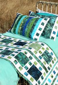 """Mosaique De Mer Bed Runner and Pillow Shams Pattern.  This gorgeous bed runner pattern measures 82"""" x 32"""" and the pillow shams are 20"""" x 30.  The warm blue/green/turquoise seas of the Caribbean were the inspiration for this calming pattern. But, make it in your own colors and create your own statement!   Use fat quarters, bali pops and jelly rolls to change up your look in no time!  http://www.kayewood.com/Mosaique-De-Mer-Bed-Runner-and-Pillow-Shams-Pattern-by-Whistlepi-WPC-MODE.htm  $9.50"""
