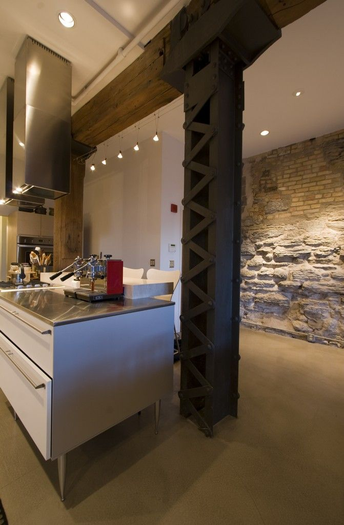 renovated loft - love the gigantic exposed wooden beams and steel pillars...