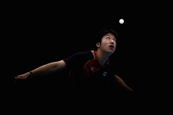 Jun Mizutani of Japan completes during Men's Team Table Tennis quarterfinal match against team of Hong Kong, China on Day 9 of the London 2012 Olympic Games at ExCeL on August 5, 2012 in London, Engla