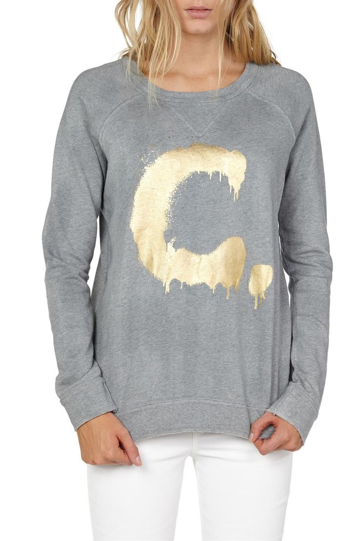 This long sleeve raglan sweater is cut for a comfortable and relaxed fit. Featuring an all over sprayed effect and a gold metallic 'C' placement print - it is a must have peice for this season. Layer yours over a cami and everything from leather-look shorts to distressed jeans.