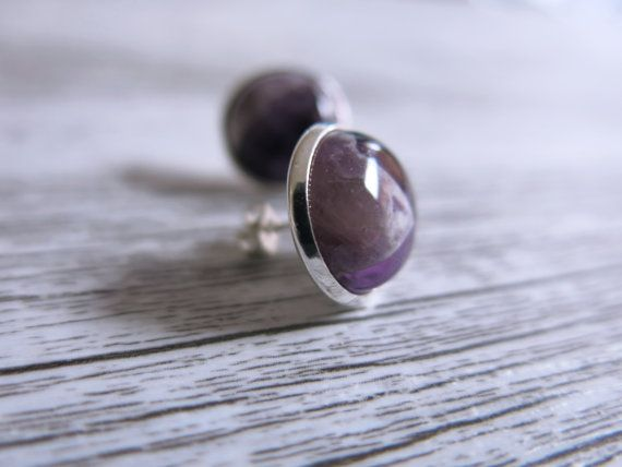 These beautiful earrings are made from large 1.5cm/.6 in diameter amethyst gemstones fixed into a stunning silver setting.  Amethyst is said to
