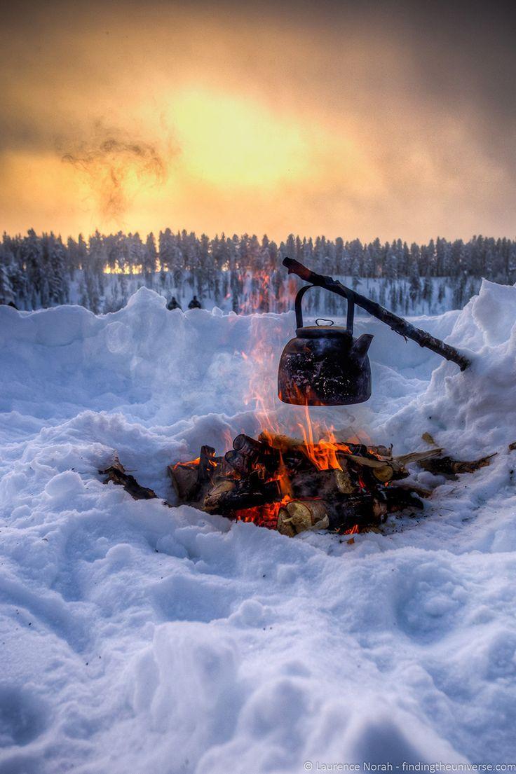 Having winter campfires in northern Finland - Visiting Finland in Winter: Top 15 Winter Activities in Finland