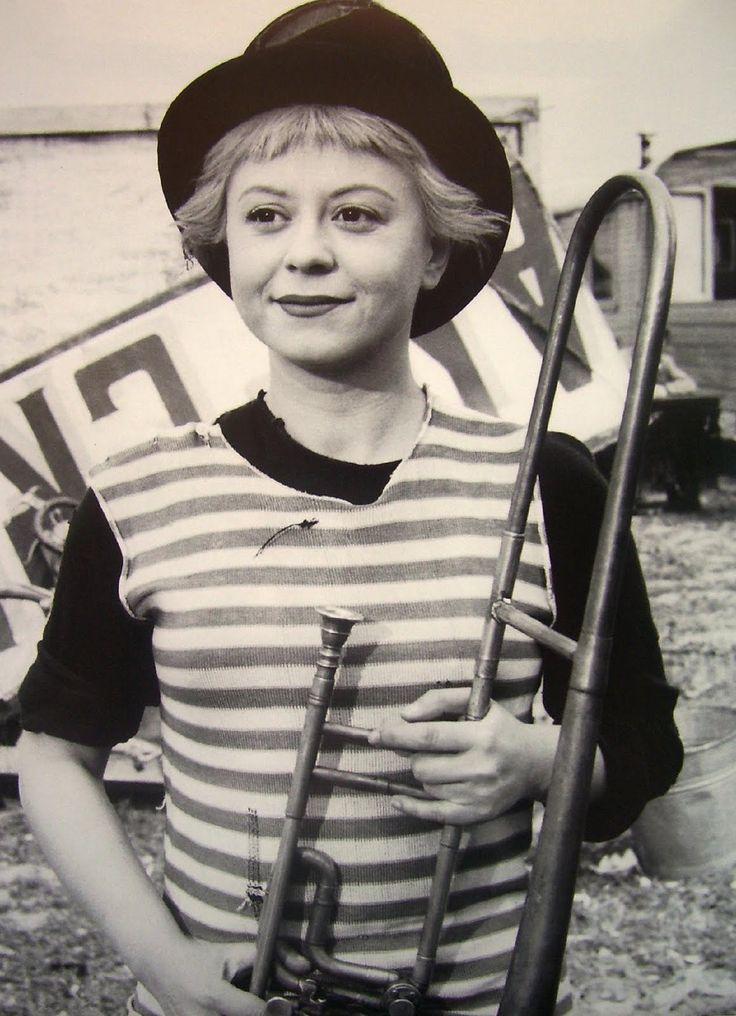 This is Giulietta Masina, an Italian actress. The photo is from La Strada (1954), a Fellini film.