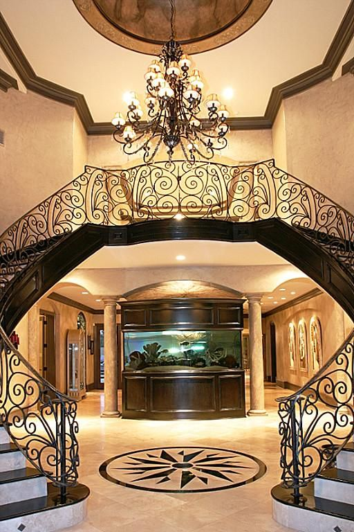 Entry With Double Staircase And Aquarium Home Decor