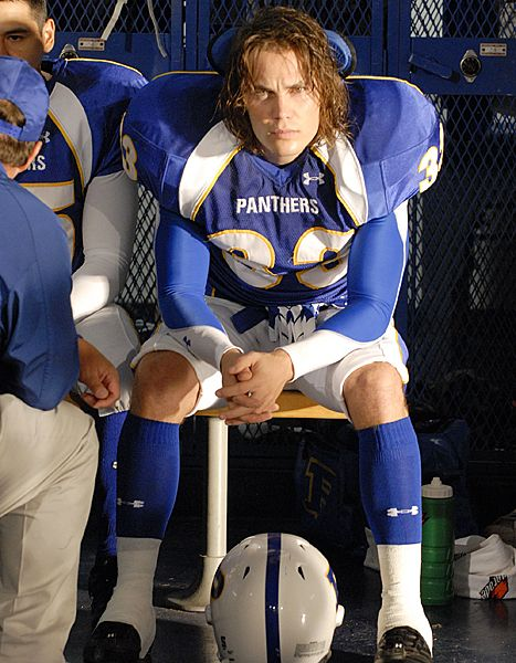 Taylor Kitsch as Tim Riggins on Friday Night Lights