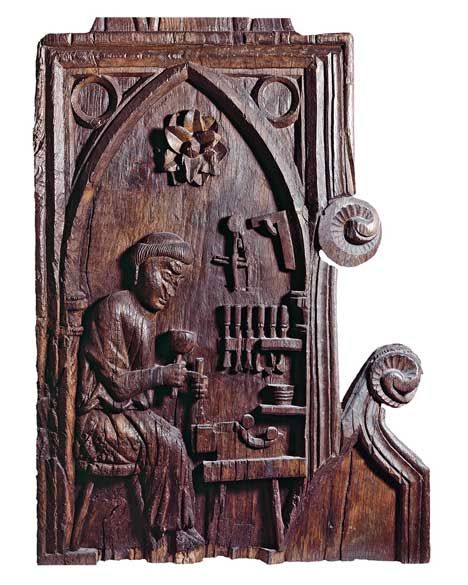 Monk at work as a joiner. Side of a choir stall from the cloister in Pöhlde, Germany, dated around 1280.