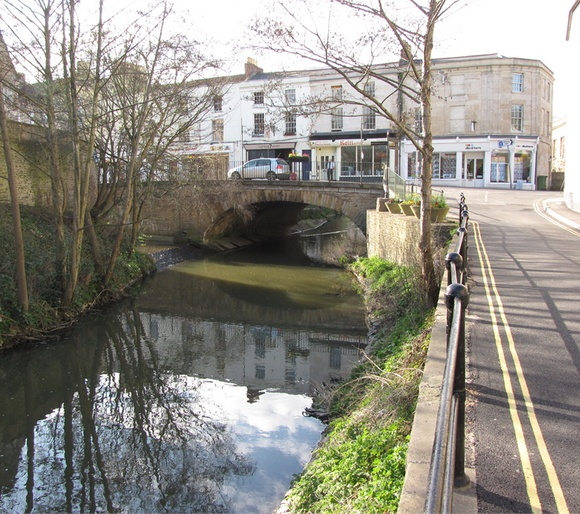 This inhabited bridge is located in Frome, a town in northeast Somerset, England. Frome Town Bridge was built in 1667. On the bridge is located building with several shops. -