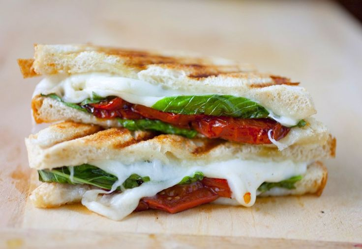 One of my favorite summer dishes is caprese salad. Sliced tomatoes, fresh mozzarella, basil leaves and balsamic vinegar offer the perfect combination of flavors. It also turns out these ingredients are a perfect grilled cheese in the making! The one issue was the balsamic vinegar--how to