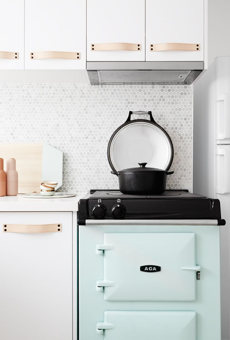 Kitchen: marble penny-round mosaic tile splashback, white cabinets, leather-strap handles, slide-out rangehood, pale turquoise/mint retro vintage oven and stove/cooktop