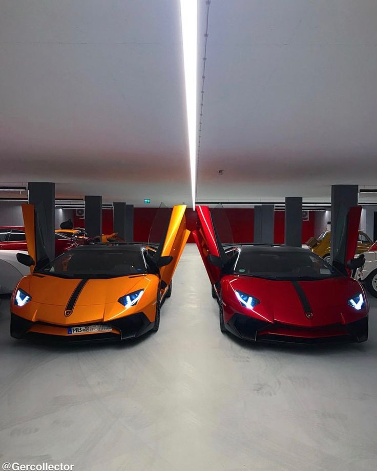 2 Lamborghini Aventador Super Veloce Roadsters painted in Rosso Bia and Arancio Atlas w/ black central stripes  Photo taken by: @gercollector on Instagram (He is also the owner of both cars)