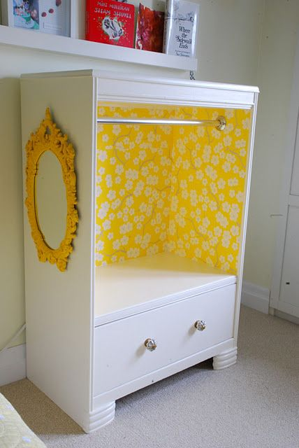 "super cute idea for a beat up set of drawers, with missing drawers. Could put her ""dress up"" clothes in it. If it had doors it would be a pint sized armoire.      Put a cushion on it and use as a pet bed. Wrap scarves or material to make curtains. Or use as a pet closet!"